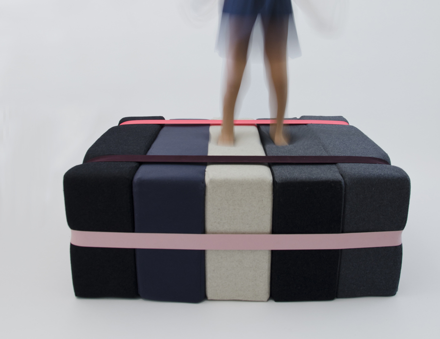 """Soft Raft / Ottoman-Bed: The Soft Raft is another model of our nomadic furniture series. Like the Sweet Seat, this ottoman seat accordions open into a full-length single bed.  Ottoman Dimensions:  92 cm X 102 cm x 37 cm  36"""" x 40"""" x 14.5""""   Mattress Dimensions: 92 cm x 184 cm x 20.4 cm  36"""" x 72.5"""" x 8""""   If you would like to receive specs and colour-ways, fill in the form below"""