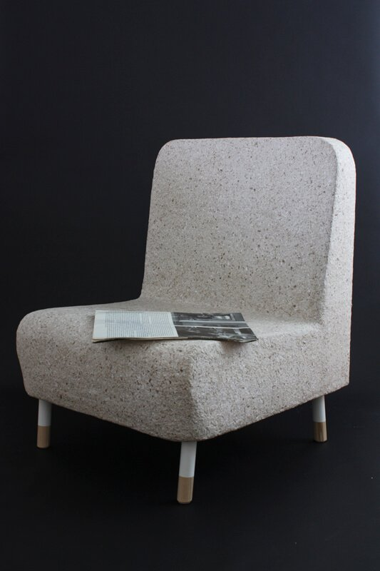 Bibliothèque Chair: This chair was made as a part of a paper tableau that was exhibited during the art in public spaces festival, KAFKA in Waterloo, Ontario. The tableau was an intervention into the lounge part of a public library where, surrounded by books, it contextually challenged the preconceptions of what paper is for and its limitations as a fragile material.   The chair was designed after chair designs of the 1960s and resembled other chairs in the lounge area. Built to be functional and comfortable, it was also accompanied by a functional paper light, table and some plants.  All parts of the tableau are currently available for purchase in our Dear Human Shop.